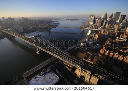 Aerial view of Lower Manhattan, Brooklyn Bridge, Manhattan Bridge, and Dombo, Brooklyn, New York - stock photo