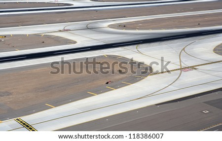 Aerial view of major airport runway and taxiway - stock photo