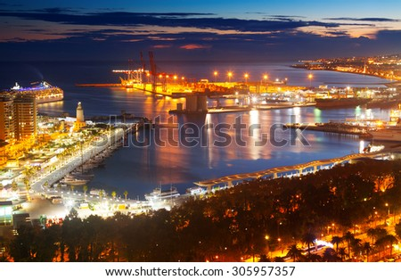 Aerial view of Malaga with Port from castle  in evening.  Spain - stock photo