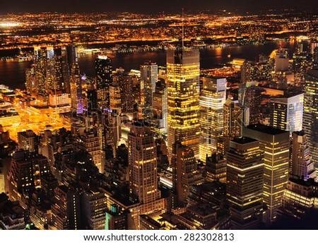 Aerial view of Manhattan New York at night - stock photo