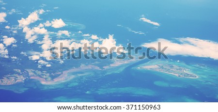 Aerial view of many islands with blue sea - stock photo