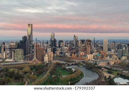 Aerial view of Melbourne, Australia skyline, taken at dawn on 15 September 2013 from a hot air balloon. The Yarra River runs through the city, with Federation Square on the northern (right) bank. - stock photo
