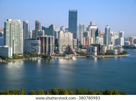 Aerial view of Miami skyline along Brickell Ave toward Biscayne Bay on cloudless morning, 2016 - stock photo