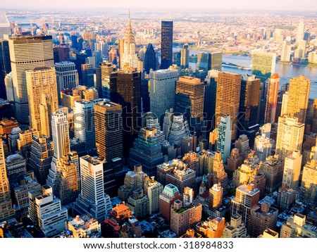 Aerial view of midtown New York City and the Hudson river at sunset - stock photo