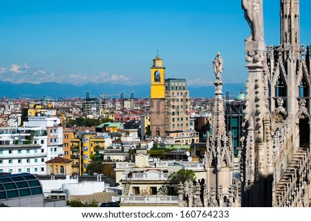Aerial view of milan downtown with dome steeple - stock photo