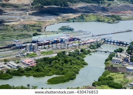 Aerial view of Miraflores Locks. Cargo ships passing through Miraflores Locks at Panama Canal. - stock photo