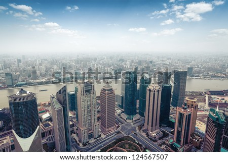 aerial view of modern city in shanghai skyline - stock photo