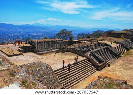 Aerial view of Monte Alban Ruins, Oaxaca, Mexico with mountains at the background - stock photo