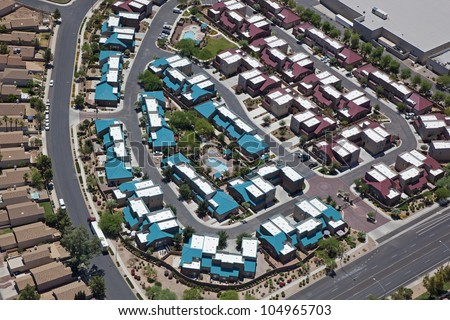 Aerial view of multicolored rooftops in a housing community - stock photo
