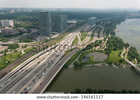 Aerial view of multiple lane highway and traffic beside lake. - stock photo