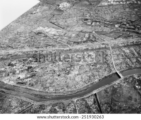 Aerial view of Nagasaki, Japan, after atomic bombing of Aug. 9, 1945. The hilly geography of Nagasaki limited the damage to the Urakami Valley and part of downtown Nagasaki. - stock photo