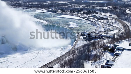 Aerial view of Niagara Falls' Horseshoe Falls. Image shows the curve of the falls as well as some of the land around this well known natural Wonder of the World.  - stock photo