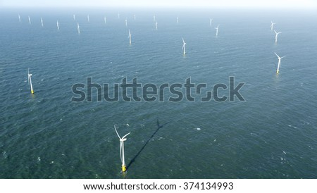 Aerial view of offshore wind turbine farm in the Noordzee at Egmond aan Zee, The Netherlands. The project is from Shell and Nuon. - stock photo
