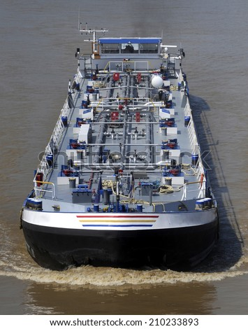Aerial view of oil tanker ship sailing on river - stock photo