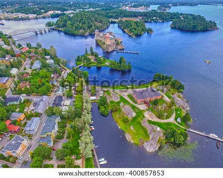 Aerial view of Olavinlinna Olofsborg Medieval Castle in Savonlinna, Finland. It is the northernmost medieval stone fortress still standing. - stock photo