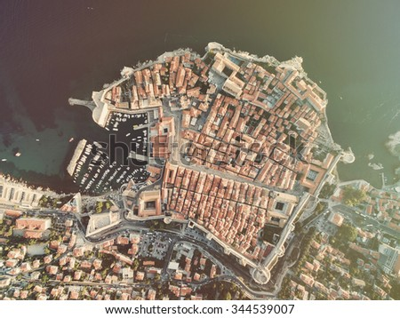 Aerial view of old city of Dubrovnik (Croatia), popular tourist attraction on Adriatic. Post processed with vintage filter. - stock photo
