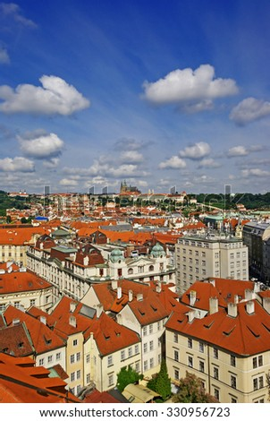 Aerial view of Old Town and Prague Castle panorama of red tiled roofs of Prague - stock photo
