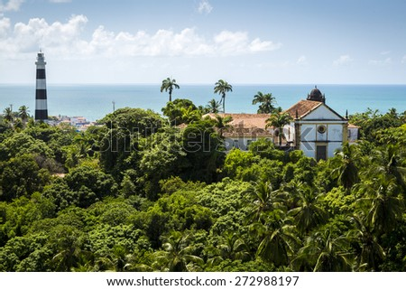 Aerial view of Olinda in Pernambuco, Brazil on a super sunny summer day showcasing some of its historic architecture and the exuberant Atlantic Forest all around. - stock photo