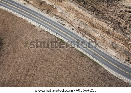 aerial view of  over the road and harvest fields in Poland - stock photo