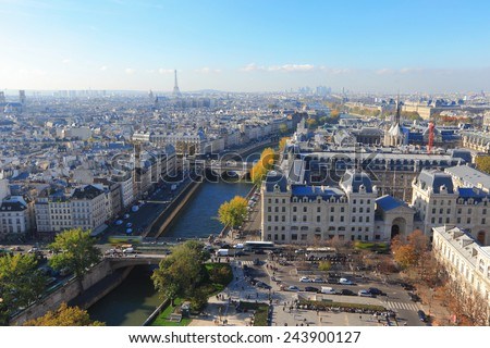 Aerial view of Paris City, eiffel tower and Seine river shot on the top of Notre Dame Cathedral. - stock photo