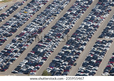 Aerial view of parking new cars - stock photo