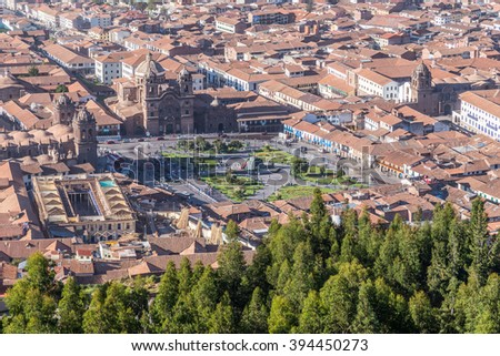 Aerial View of Plaza de Armas, Cusco, and Andes Mountains in Peru by day - stock photo