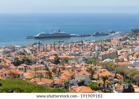 Aerial view of Portuguese Funchal with a big cruise ship in the harbor - stock photo