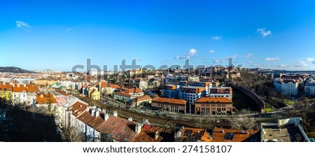 aerial view of prague taken from vysehrad castle complex captures detail of typical red rooftops as well as hundred towers all over the city. - stock photo