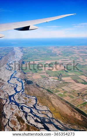 Aerial View of Rakaia river and Canterbury Plains, New Zealand - stock photo