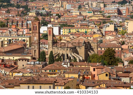 Aerial view of red tiled rooftops and ancient Due Torri towers in historical center of Bologna, Italy - stock photo