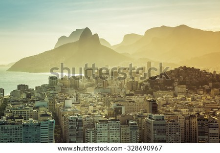 Aerial view of Rio de Janeiro buildings with Ipanema Beach, Brazil. Afternoon warm light - stock photo