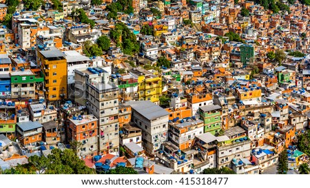 Aerial view of Rio's Rocinha favela, on a sunny afternoon. - stock photo