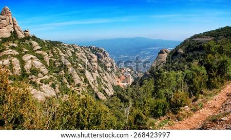 Aerial view of Santa Maria de Montserrat Monastery and Mountains in Catalonia, Spain - stock photo