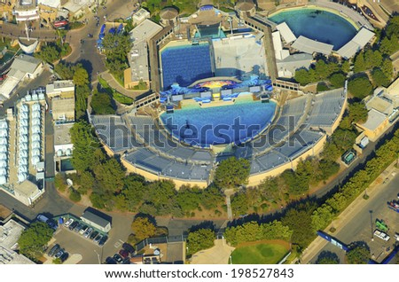 Aerial view of SeaWorld, a marine life theme park in San Diego Bay in Southern California, United States of America. A view of the killer whale shamu stadium and the show pools around. - stock photo