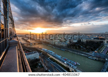 Aerial view of Seine River, high above Paris during sunset, from highest observation deck on Eiffel Tower - stock photo