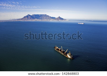 Aerial view of ship in Table Bay with Table Mountain, Cape Town, South Africa - stock photo