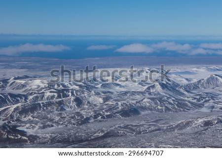 Aerial view of showy mountains during winter, Iceland - stock photo