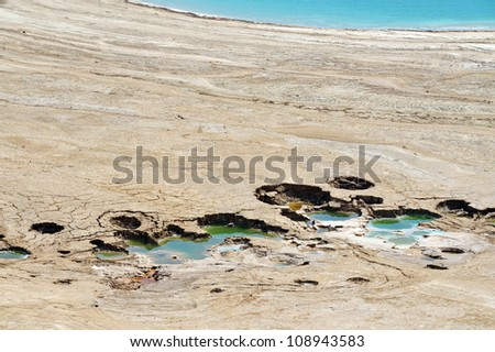 Aerial view of sinkholes in the Dead Sea, Israel. - stock photo