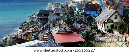 Aerial View of Small Architectural Houses Near the Beautiful Tranquil Ocean. - stock photo