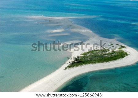 Aerial view of small tropical island of the coast of Mozambique, southern Africa - stock photo