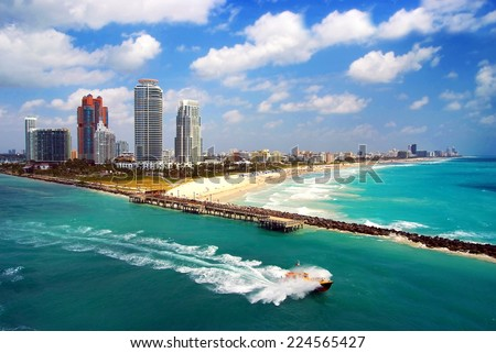 Aerial view of South Miami Beach with Pilot boat sailing next to the city line - stock photo