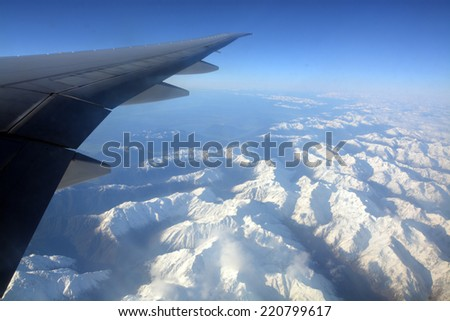 Aerial View of Southern Alps of New Zealand traveling West from Christchurch to Australia in Spring. - stock photo