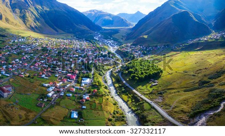 Aerial view of Stepantsminda Kazbegi small town near mountain Kazbek in Georgia, photo made with drone - stock photo
