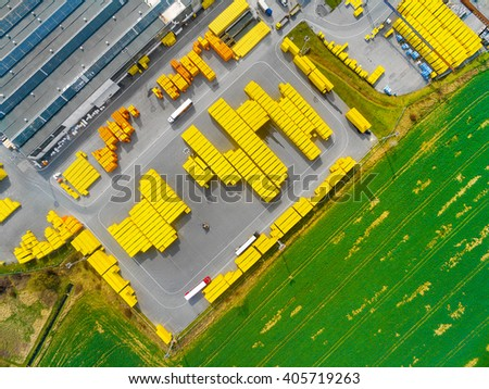 Aerial view of storage and freight terminal with trucks and containers. Industrial background.  - stock photo