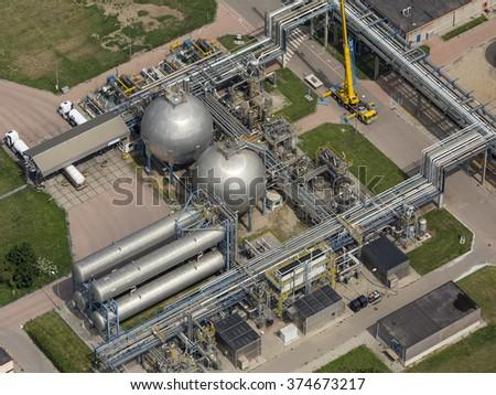 Aerial view of storage tanks with fertilzer at Yara Sluiskil, Netherlands. - stock photo