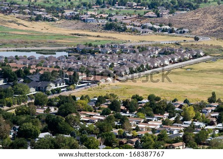 Aerial view of suburban neighborhoods as developments sprawl out into surrounding open areas in Reno, Nevada, USA. - stock photo