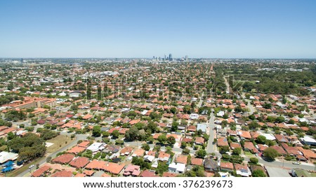 Aerial view of suburbs surrounding Perth WA, with Perth in the background. - stock photo