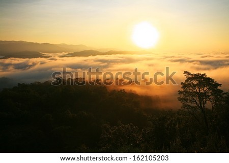 Aerial view of Sunrise over mountain and fog in Tak province, Thailand - stock photo