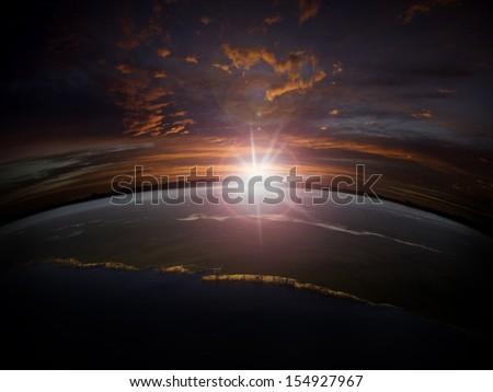 Aerial view of sunrise/sunset over a rocky coastline. Digital photo manipulation.  - stock photo