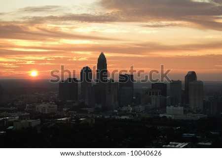 Aerial view of sunset behind city skyline of Charlotte, North Carolina. - stock photo